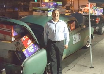 Rafael has loaded his 1951 Chevy for diaper drive
